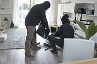 Two burglars at work in an one-family house at daytime - ONF000614