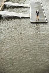 Germany, Hesse, Frankfurt, young man standing on a jetty taking a selfie with his digital tablet - UUF001828