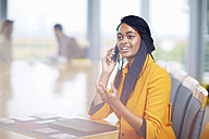 Portrait of businesswoman telephoning with smartphone - ZEF001007