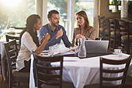 Business meeting of three people in a restaurant - ZEF000895