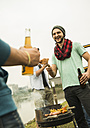 Group of friends drinking beer and having a barbecue - UUF001857