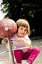 Happy little girl on playground - LVF001885