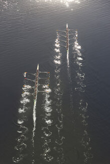Elevated view of two rowing eights in water - ZEF000454