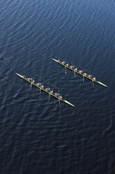 Elevated view of two rowing eights in water - ZEF000457