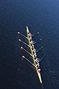 Elevated view of female's rowing eight in water - ZEF000482