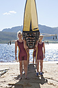 Female rowers lifting up boat - ZEF000928