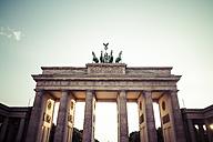 Germany, Berlin, Berlin-Mitte, Brandenburg Gate in the evening light - KRPF001167