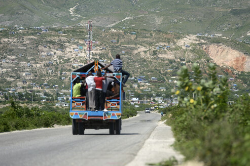 Haiti, Port-au-Prince, Workers on truck looking for jobs - FLK000423
