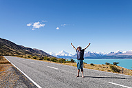 New Zealand, South Island, Lake Pukaki, young man standing on empty road - WVF000650