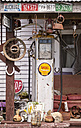 New Zealand, South Island, Ross, view to an old petrol pump and other decoration in front of a house - WV000716