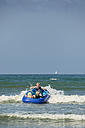 France, Brittany, Department Finistere, Sainte-Anne-la-Palud, Man with children in an inflatable boat - LAF001138