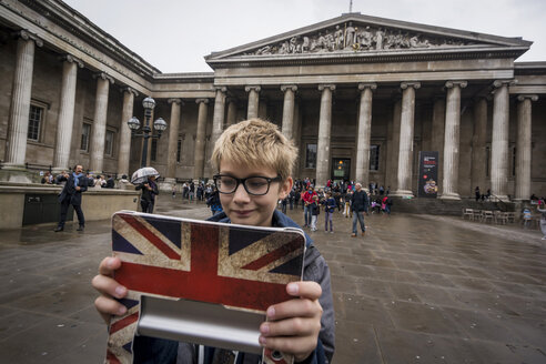 UK, London, boy standing in front of British Museum taking a selfie with his digital tablet - PAF000951