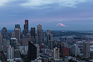 USA, Washington State, Seattle, Cityscape in the evening light, Mount Rainier in the background - FOF007127