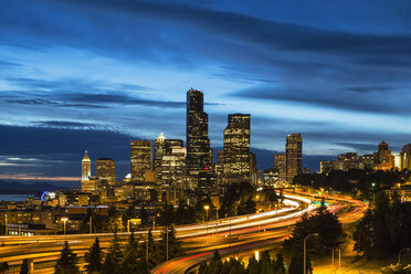 USA, Washington State, Seattle, Dr. Jose Rizal Park, Interstate 5 and skyline at blue hour - FOF007187