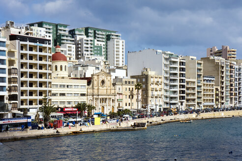 Malta, Sliema, historical building between new buildings at waterfront - WEF000242
