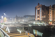 Germany, Hamburg, Hafencity, Bridge at night, foggy - NKF000178