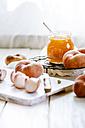 Sliced and whole doughnut peaches and a glass of peach jam - SBDF001254
