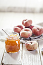 Glass of peach jam and doughnut peaches - SBDF001258