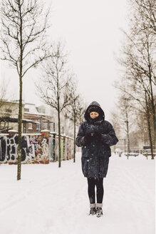 Germany, Saxony, Leipzig, Plagwitz, woman standing on the way - DWF000182