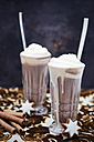 Two glasses of hot chocolate with cream, cinnamon stars and cinnamon sticks on cloth - CZF000169
