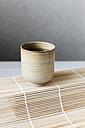 Cup of green tea on bamboo mat - EVGF000918