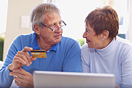 Senior couple shopping online at home - ZEF001073