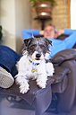 Man with dog relaxing at home - ZEF001276