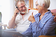 Senior couple shopping online at home - ZEF001092