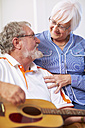Senior man with wife at home playing guitar - ZEF001102