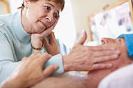 Senior woman caring for sick husband at home - ZEF001155