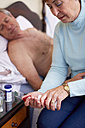 Senior woman caring for sick husband at home - ZEF001158