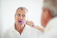 Senior man brushing teeth - ZEF001165