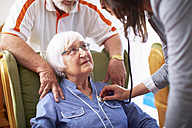 Medic caring for senior woman at home - ZEF001167