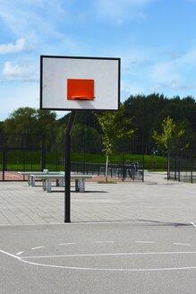 Netherlands, Flevoland, Almere, basketball field on playground - HAWF000469