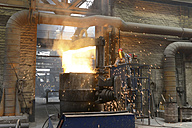 Worker checking temperature of material in a foundry - SCH000416