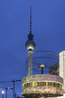 Germany, Berlin, view to television tower and tworl clock at Alexanderplatz by twilight - NKF000191