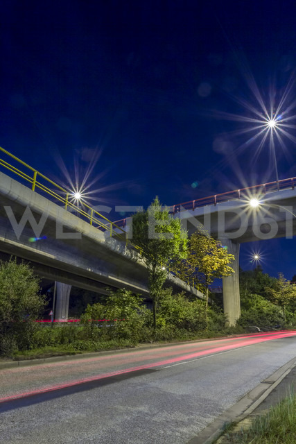 Germany, Hamburg, two bridges crossing each other at night - NKF000192