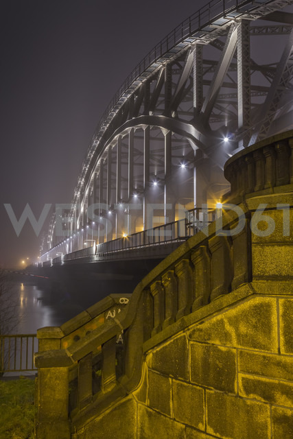 Germany, Hamburg, historic Elbe bridge in dense fog at night - NK000194