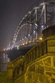 Germany, Hamburg, historic Elbe bridge in dense fog at night - NK000194