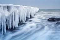 Germany, Mecklenburg-Western Pomerania, Kuehlungsborn, iced jetty at the Baltic Sea - NKF000203