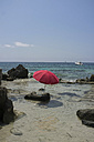 Spain, Balearic Islands, Ibiza, Las Salinas, sunshade on a rock - TKF000401