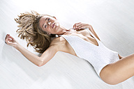 Young woman wearing white bodystocking - MAEF009197