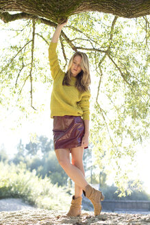 Young woman wearing knit pullover and mini skirt - MAEF009175