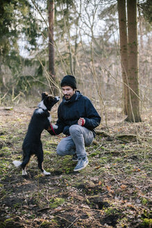Germany, Man with Border Collie - DWF000198