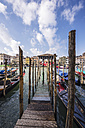 Italy, Veneto, Venice, Cannaregio District, Wooden boardwalk by the canal - THAF000615