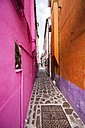 Italy, Veneto, Venice, Burano,  Colourful houses and alleyway - THAF000630