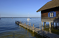 Germany, Bavaria, Upper Bavaria, near Herrsching, Ammersee lake, boathouse and wooden jetty - LHF000418