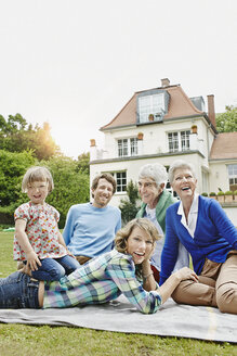 Germany, Hesse, Frankfurt, Three generations family in front of villa - RORF000078