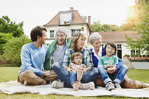 Germany, Hesse, Frankfurt, Three generations family in front of villa - RORF000080