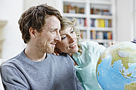 Germany, Hesse, Frankfurt, Adult couple at home, planning world tour - ROR000086